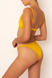 mustard bikini bottom on body back view