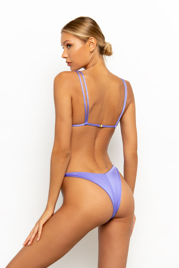 Back view of Sommer Swim model on white background wearing the Rocha Cheeky Bikini Bottom in colour-way Provenza
