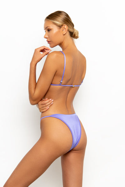Sommer Swim model wearing the Eden Cheeky Bikini Bottom in colour Provenza standing sideways