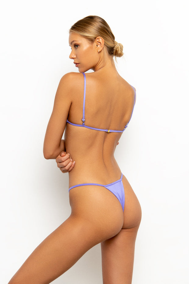 Back view of Sommer Swim model on white background wearing the Jane Thong Bikini Bottom in colour-way Provenza