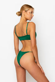 Sommer Swim model facing backwards and wearing Cara brazilian bottom in Emerald