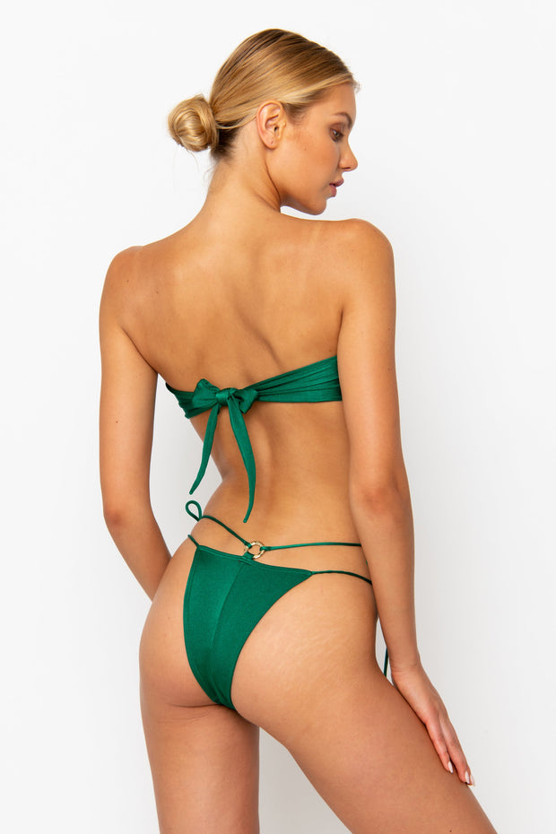 Sommer Swim model facing backwards and wearing the Cece Bandeau Bikini top in emerald.