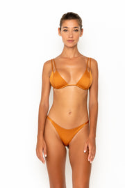 Sommer Swim model facing forwards and wearing Daria bralette bikini top in Papagayo