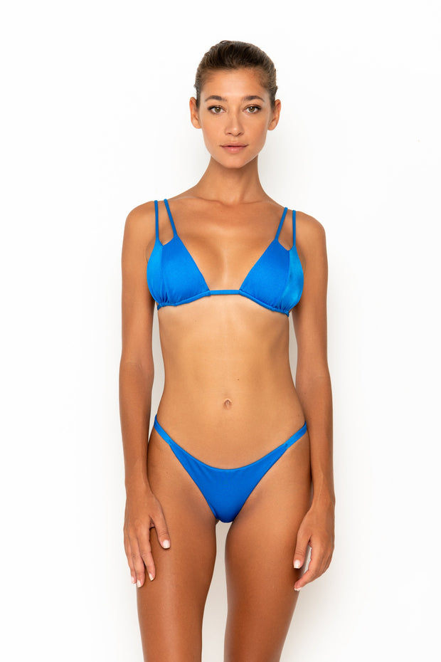 Sommer Swim model facing forwards and wearing Rocha cheeky bikini bottoms in Sirius
