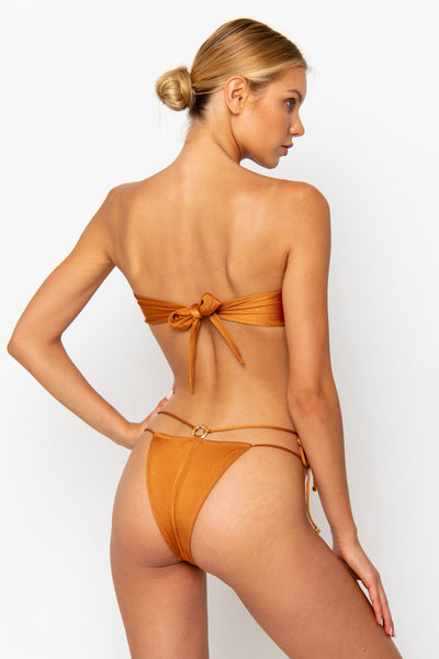 Sommer Swim model facing backwards and wearing a Dulce brazilian bottom in Papagayo