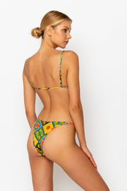 Sommer Swim model is facing backwards and wearing a Eden cheeky bikini bottom in Baroque