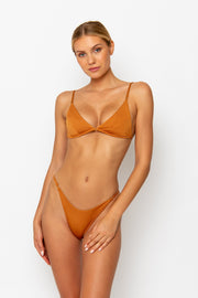 Sommer Swim model facing forwards and wearing a Eden cheeky bikini bottom in Papagayo