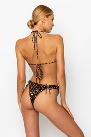 Sommer swim model facing backwards and wearing Esmee adjustable halter style bikini top in Leopard Luxe