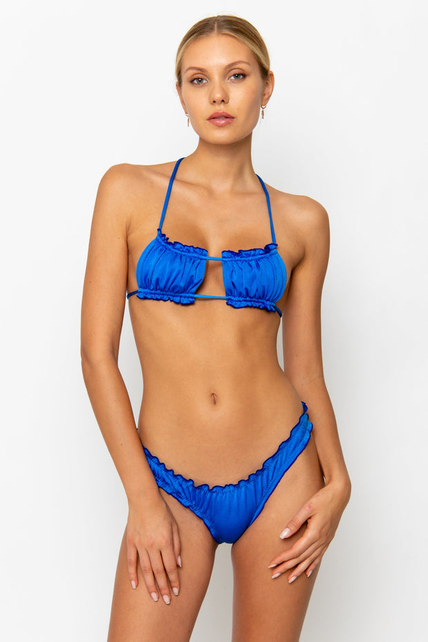 Sommer Swim model facing forwards wearing a Esmee adjustable halter style bikini top in Sirius