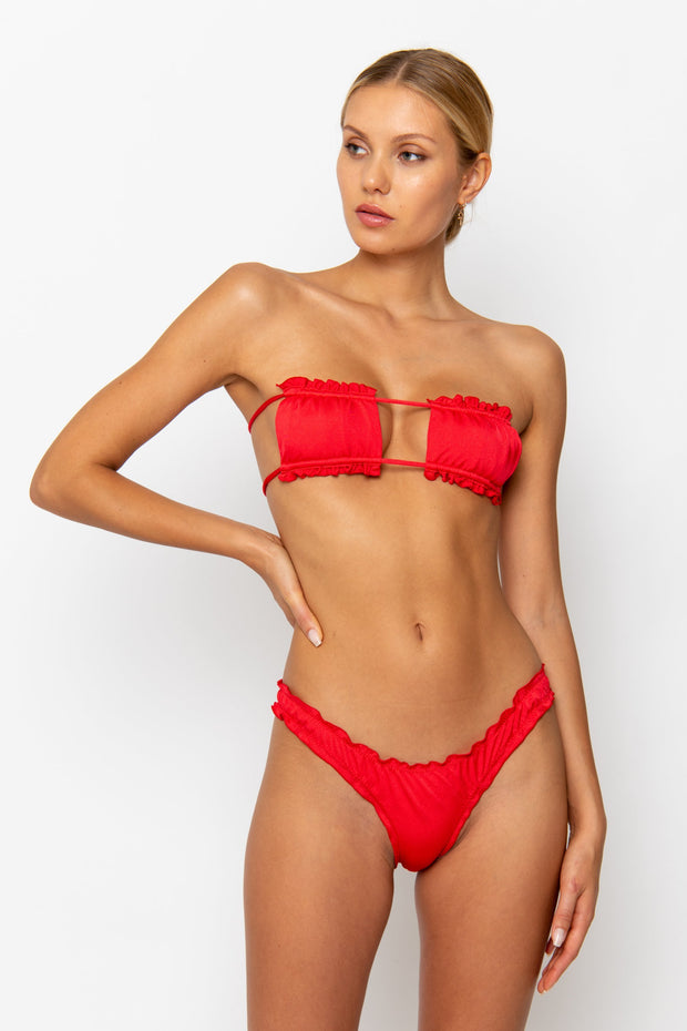 Sommer Swim model facing forwards and wearing Esmee adjustable bandeau style bikini top in Venere