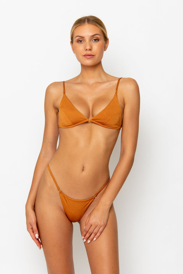 Sommer Swim model facing forwards and wearing a Jane thong bikini bottom in Papagayo