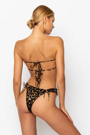 Sommer Swim model facing backwards and wearing a Josephine brazilian bikini bottom in Leopard Luxe