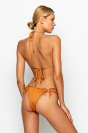 Sommer Swim model facing backwards and wearing a Josephine brazilian bikini bottom in Papagayo