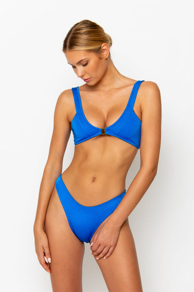 Sommer Swim model facing forwards and wearing a Jourdan bralette bikini top in Sirius