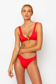 Sommer Swim model facing forwards and wearing a Jourdan bralette top in Venere