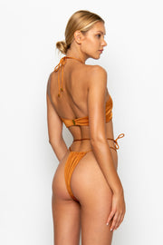 Sommer Swim model facing backwards and wearing a Naomi tie side bikini bottom in Papagayo