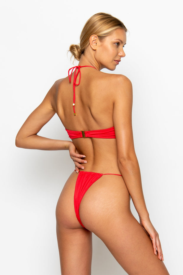 Sommer Swim model facing backwards and wearing a Naomi tie side bikini bottom in Venere
