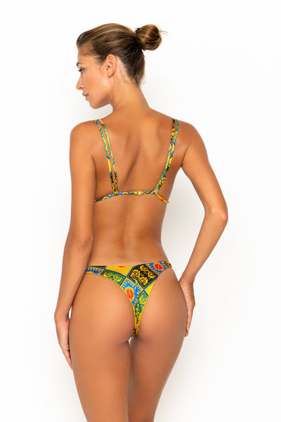 Sommer Swim model facing backwards and wearing Rocha cheeky bikini bottoms in Baroque
