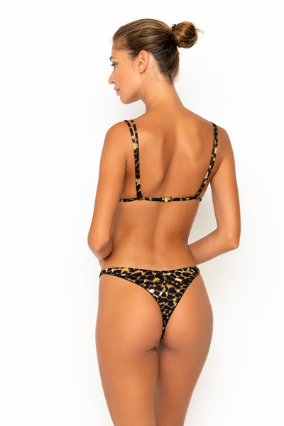 Sommer Swim model facing backwards and wearing Rocha cheeky bikini bottoms in Leopard Luxe