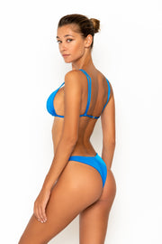 Sommer Swim model facing backwards and wearing Rocha cheeky bikini bottoms in Sirius
