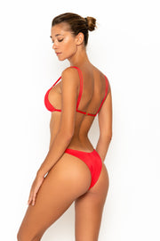 Sommer Swim model facing backwards and wearing Rocha cheeky bikini bottoms in Venere