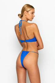 Sommer Swim model facing backwards and wearing a Xena halter style bikini top in Sirius