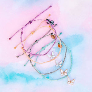 Pura-Vida-Save-the-Butterflies-Charm-Bracelet-Flatlay