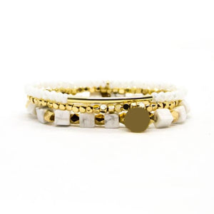 gold and white bracelet stack