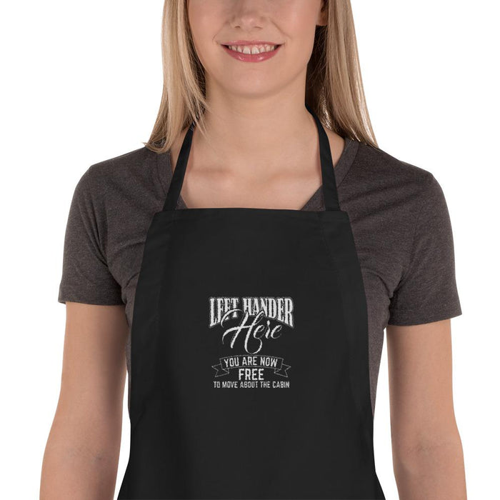 Left Hander Here. You Are Now Free To Move About The Cabin Embroidered Apron | Black