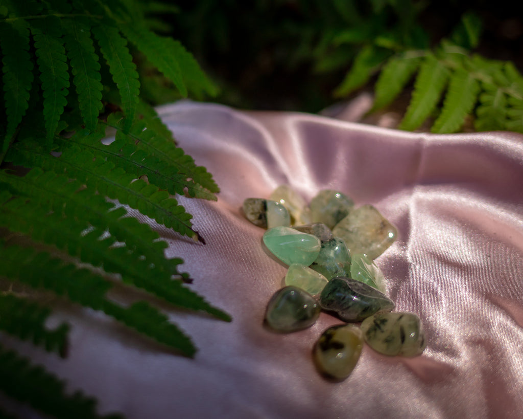 Prehnite in Epidote Tumbles for Potent Healing and Growth - The Crystal Cavern