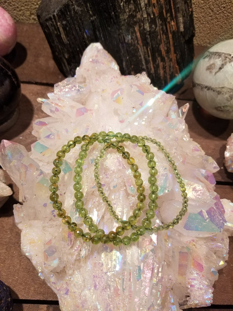 Peridot Bracelets for Cyclical Alignment - The Crystal Cavern