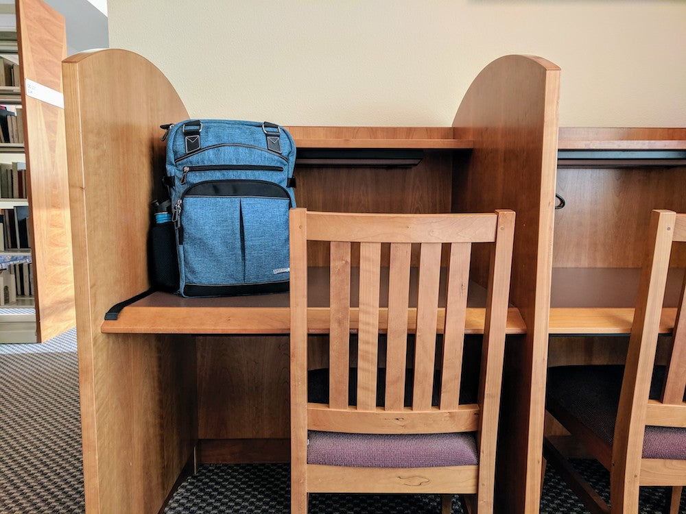 Studying at library - Best backpacks for college students with laptops