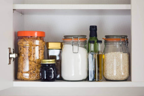 Pantry filled with food and glass containers