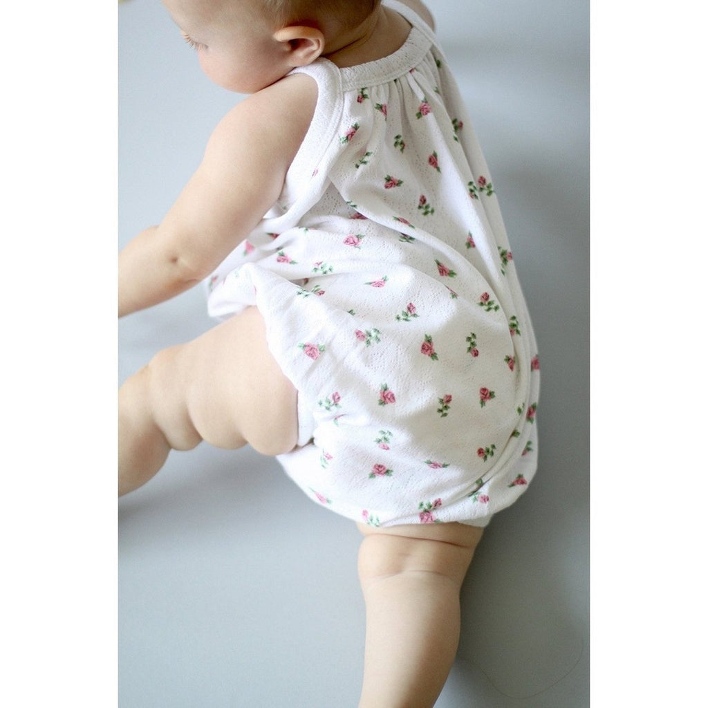baby girl wearing the Sapling Child playsuit which is beautifully soft