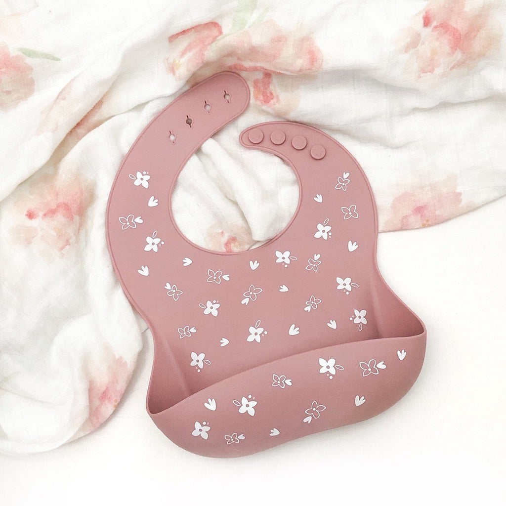 Pink baby catch bib from One Chew Three