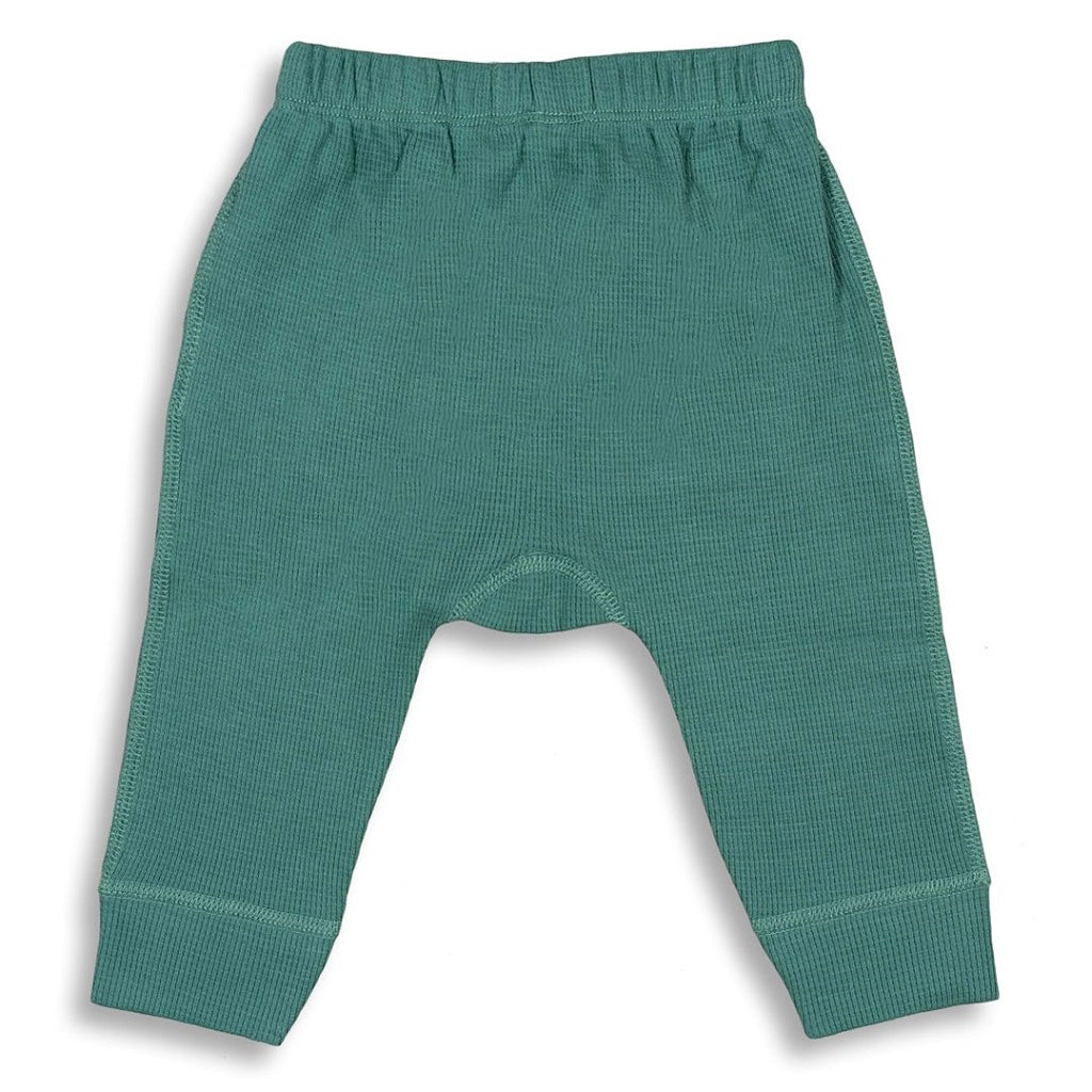 Unisex green pants made from organic waffle cotton for babies and toddlers