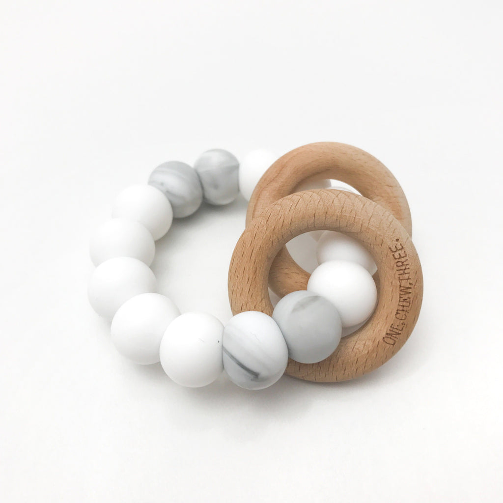 One.Chew.Three Rattle Silicone and Wood Teether White Marble