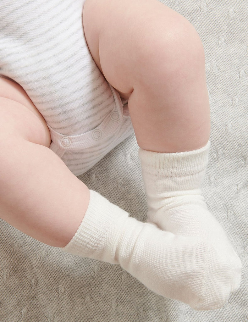 white Purebaby socks for babies
