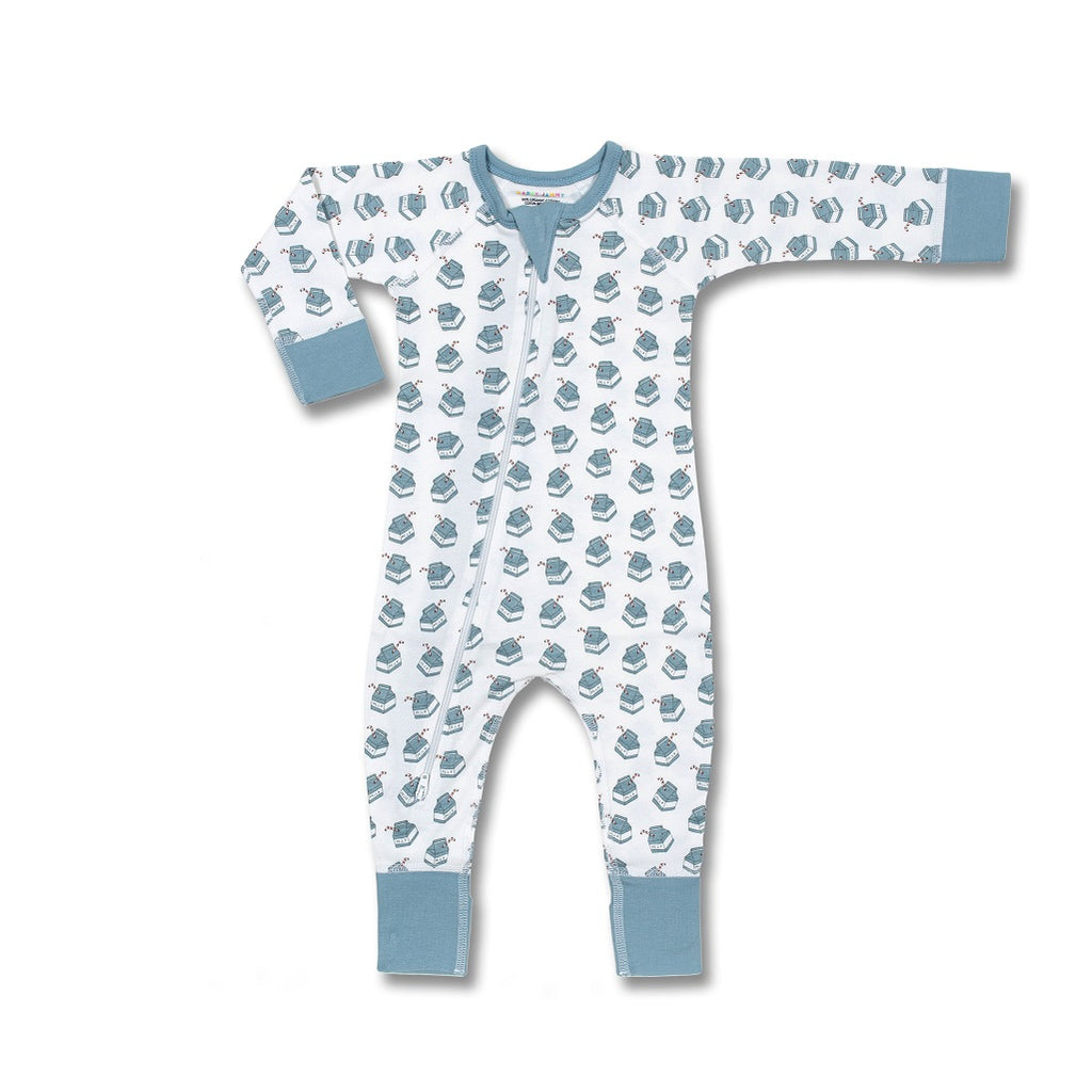 Gender neutral zip romper with a milk bottle print on it