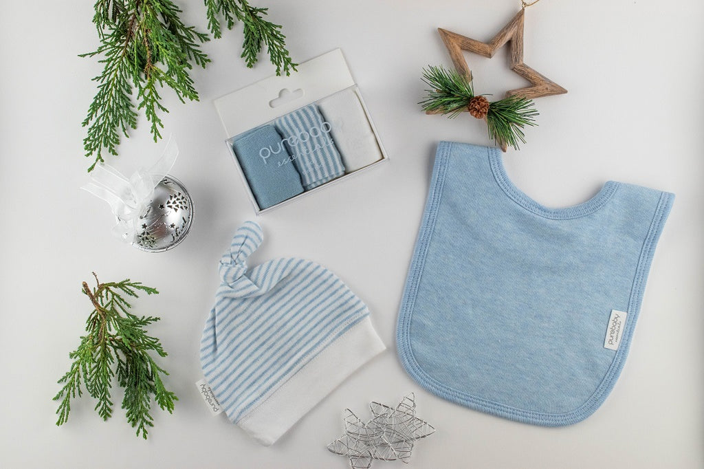 Christmas gift set for a baby boy including a bib, beanie and 3 pairs of socks
