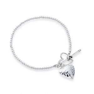 Fine bead bracelet with hammered heart charm