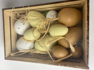 Assorted decorative wooden box of eggs