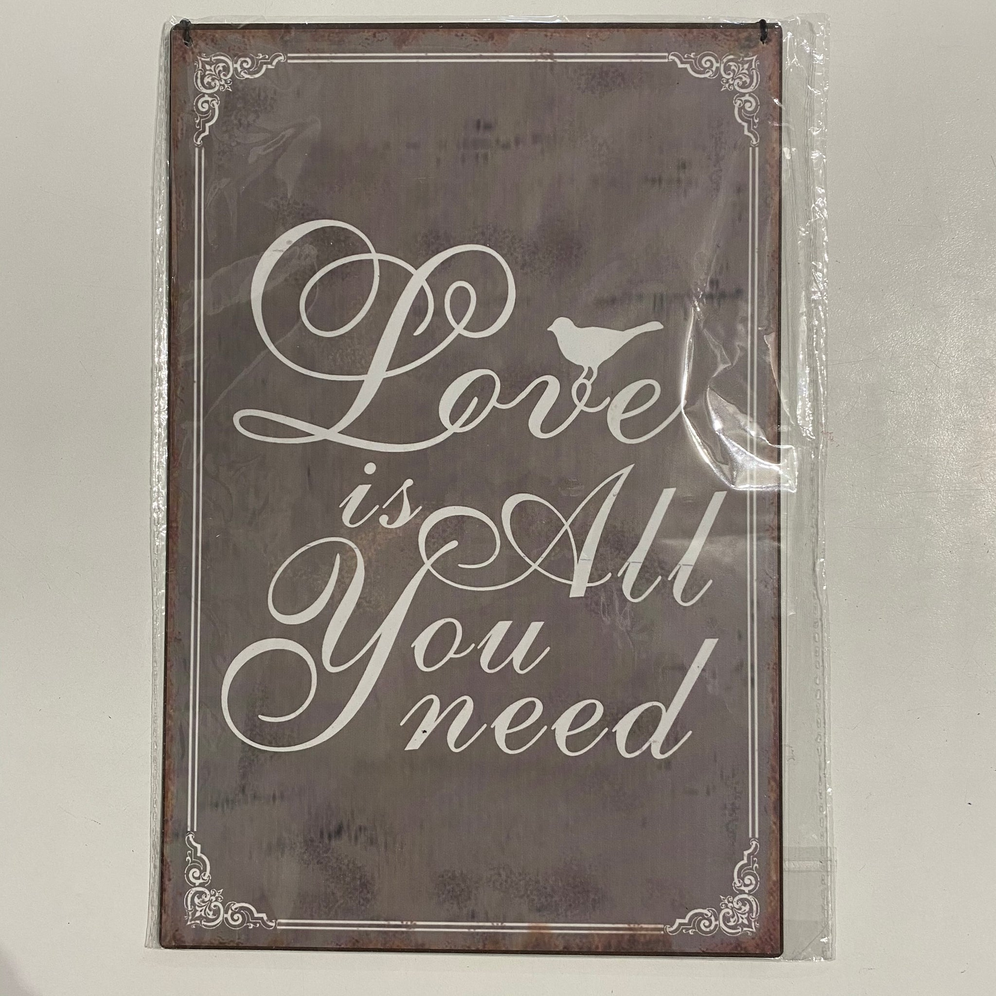 'Love is all you need' Plaque