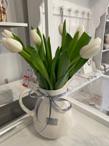 Large jug or vase or similar of white or yellow tulips
