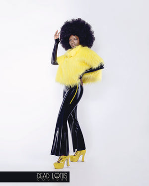 BESTIA black latex bell bottom trousers with hip zippers worn with yellow Fur Top by Dead Lotus Couture on female model