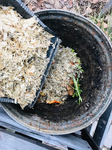 adding dry material wood shavings to compost
