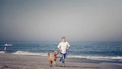Running with dog using Coast leash on the beach