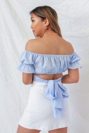 WildRina.com Wild Rina Women's Boutique | Blue Weekend Stroll Top | Crop Wrap Peasant off the shoulder top with puff sleeve detail