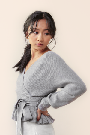 WildRina.com | Wild Rina Ruffle Me Up Sweater | Gray ruffle hemline wrap surplice sweater