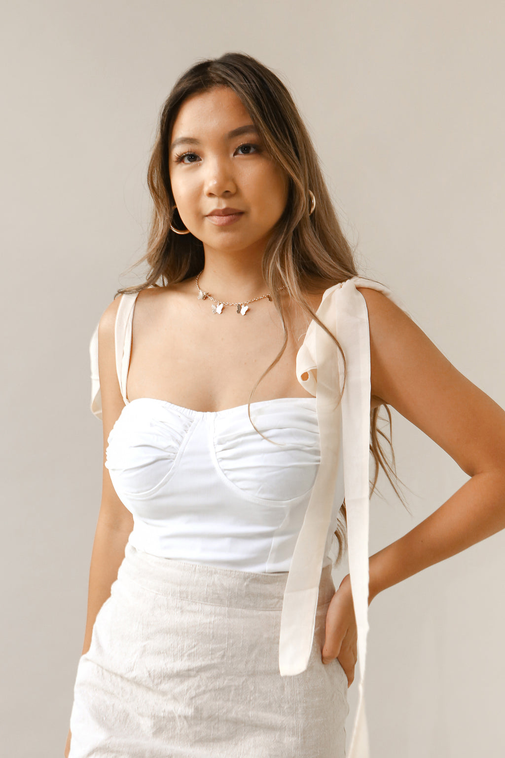 wild rina womens boutique trendy boho cute bow tie ribbon sleeve top tank top white off white cream chiffon ties